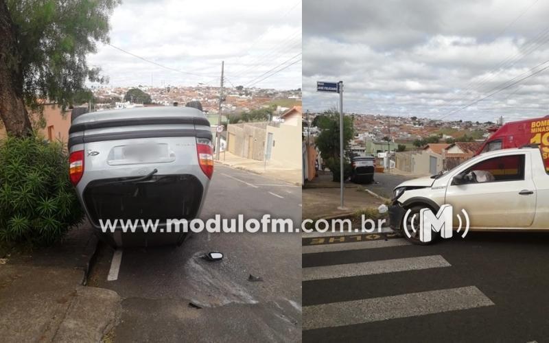 Veículo capota após colisão com outro carro, e uma pessoa fica ferida